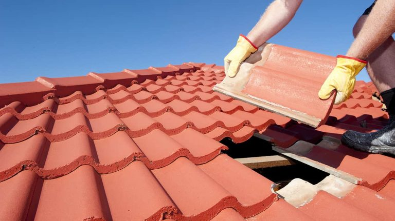 Roofing contractor installing shingles on a roof