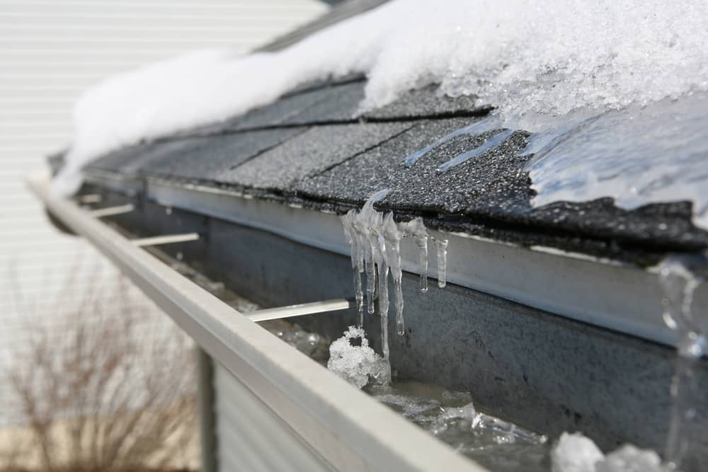 Ice on shingles and in a house drain