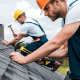 Roofers working on the roof of a house