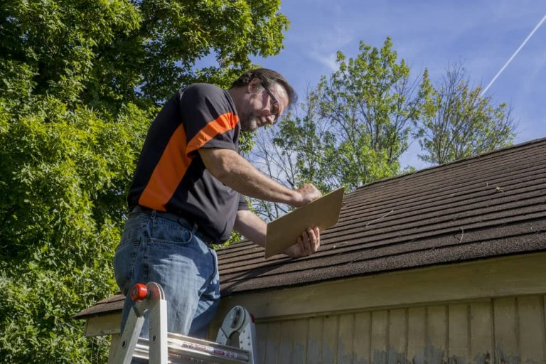 Roof contractor inspecting a roof