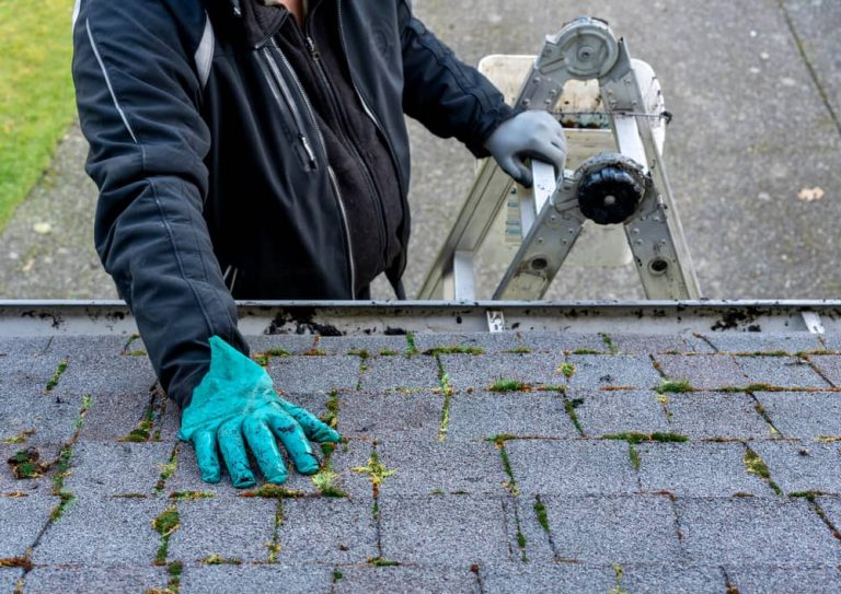 Roofer checking the tiles of a roof
