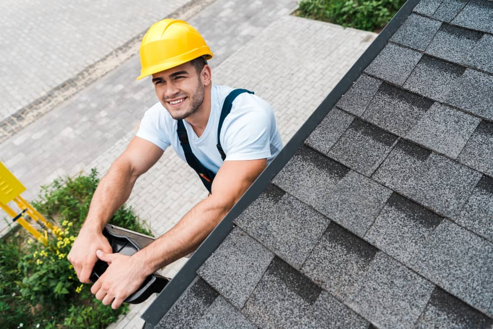 roofer inspecting the roof after finishing his job